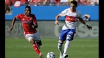 Toronto FC midfielder Marco Delgado (18) makes a pass as FC Dallas midfielder Carlos Gruezo (7) gives chase during the first half of an MLS soccer match, Saturday, July 1, 2017, in Frisco, Texas. (AP Photo/Tony Gutierrez)