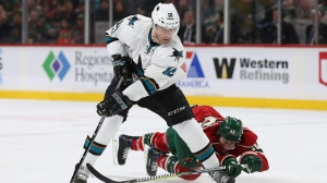 San Jose Sharks' Patrick Marleau (12) gains control of the puck against Minnesota Wild's Jared Spurgeon (46) in the second period of an NHL hockey game Tuesday, March 21, 2017, in St. Paul, Minn. (Stacy Bengs/AP Photo)
