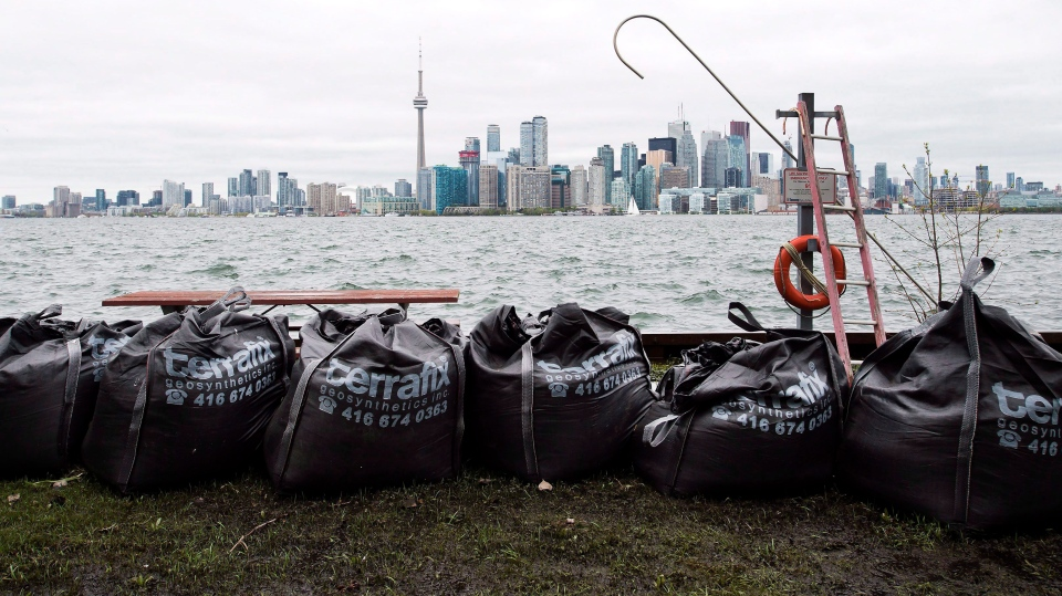 Sand bags keep water from flooding the land more as the Toronto Islands are threatened by rising water levels in Toronto on Friday, May 19, 2017. (Nathan Denette/The Canadian Press)