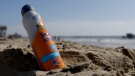 A bottle of in Banana Boat sunscreen is placed in the sand near the Newport Beach pier in Newport Beach Calif., Friday, Oct. 19, 2012. (Chris Carlson/AP Photo)
