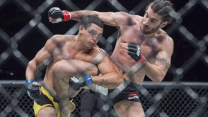 Elias Theodorou, right, of Mississauga, Ont., battles Cezar Ferreira, of Brazil, in middleweight UFC Fight Night action, in Halifax on Sunday, Feb. 19, 2017. THE CANADIAN PRESS/Andrew Vaughan