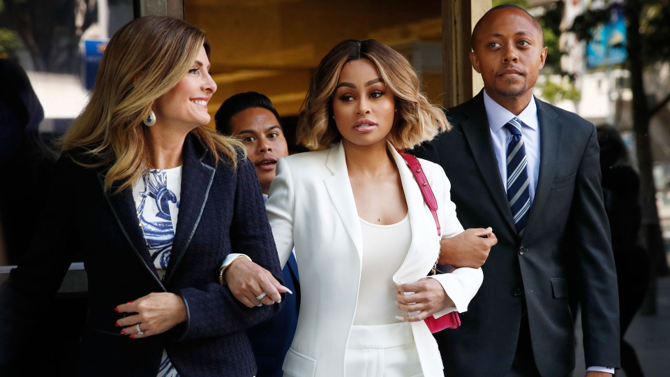 Blac Chyna, center, is flanked by her attorneys, Lisa Bloom, left, and Walter Mosley, as she leaves a courthouse after a hearing on Monday, July 10, 2017, in Los Angeles. (AP Photo/Jae C. Hong)
