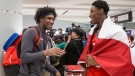 R.J. Barrett, right, and Abu Kigab arrive at Toronto's Pearson Airport with other members of Canada's under-19 Basketball team after winning gold at the U19 FIBA World Cup, in Toronto on Monday, July 10, 2017. THE CANADIAN PRESS/Chris Young