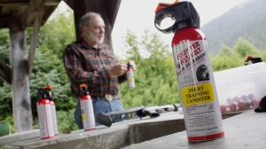 Former Alaska Department of Fish and Game biologist John Hechtel prepares to fire can of inert bear spray during a training session focusing on bear deterrents Thursday, July 24, 2014, in Wrangell, Alaska. (AP Photo/Capital City Weekly, James Brooks)