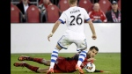 Toronto FC defender Steven Beitashour (33) goes down as Montreal Impact defender Kyle Fisher (26) vies for control of the ball during second half Canadian Championship soccer action in Toronto on June 27, 2017. Toronto FC fullback Steven Beitashour, injured in a collision with Montreal's Kyle Fisher in the Canadian Championship finale on June 27, has been released from hospital.The 30-year-old defender underwent surgery the day after the Montreal game for a damaged pancreas. THE CANADIAN PRESS/Nathan Denette