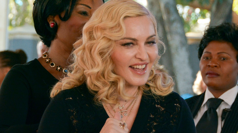 US singer Madonna smiles at the opening of The Mercy James Institute for Pediatric Surgery and Intensive Care, located at the Queen Elizabeth Central Hospital in the city of Blantyre, Malawi, Tuesday, July 11, 2017.  (AP Photo Thoko Chikondi)