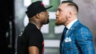 Floyd Mayweather, left, and Conor McGregor exchange harsh words during a promotional tour stop in Toronto on Wednesday, July 12, 2017, for their upcoming boxing match in Las Vegas. THE CANADIAN PRESS/Christopher Katsarov
