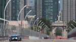 Cars zoom down the front straight towards Princes' Gate during the second practice session for the Honda Indy Toronto, in Toronto on Friday, July 14, 2017. (Frank Gunn / THE CANADIAN PRESS)
