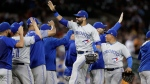 Toronto Blue Jays right fielder Jose Bautista greets teammates after the Blue Jays' 7-2 win over the Detroit Tigers in a baseball game, Friday, July 14, 2017, in Detroit. (AP Photo/Carlos Osorio)