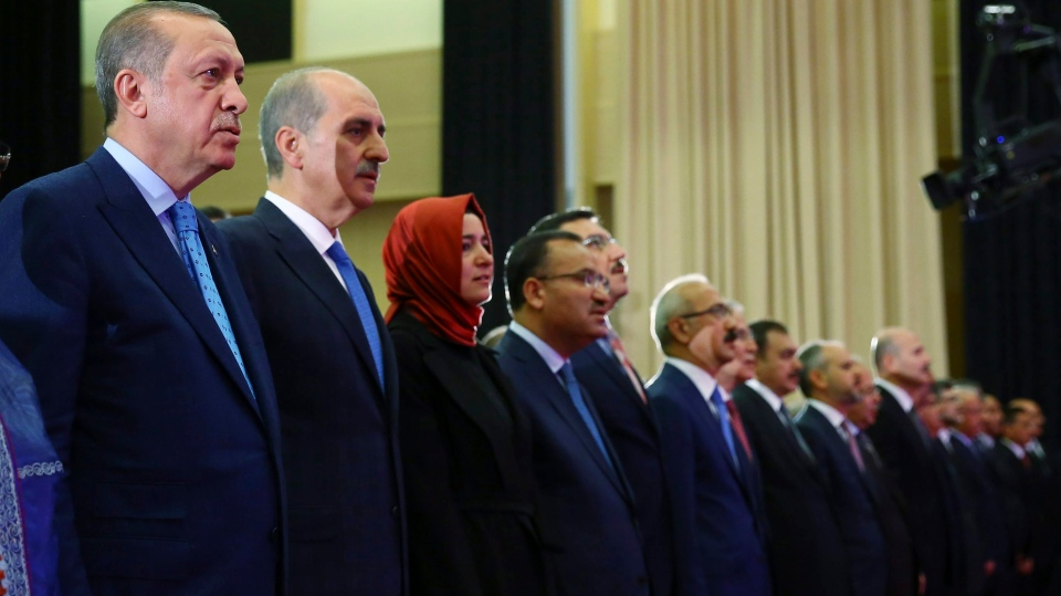 Turkey's President Recep Tayyip Erdogan, left, attends a ceremony marking the July 15, 2016 failed coup attempt anniversary, in Ankara, Turkey, Friday, July 14, 2017. Turkey commemorates the first anniversary of the July 15 failed military attempt to overthrow Erdogan, with a series of events honouring some 250 people who were killed across Turkey while trying to oppose coup-plotters.(Presidency Press Service/Pool Photo via AP)