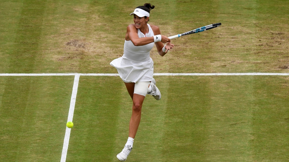 Spain's Garbine Muguruza returns to Venus Williams of the United States during the Women's Singles final match on day twelve at the Wimbledon Tennis Championships in London Saturday, July 15, 2017. (Facundo Arrizabalaga/Pool Photo via AP)