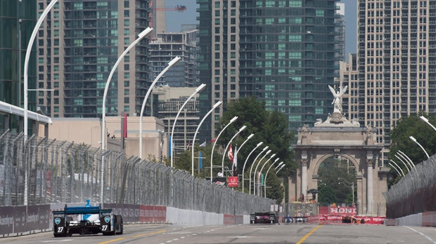 Cars zoom down the front straight towards Princes' Gate during the second practice session for the Honda Indy Toronto, in Toronto on Friday, July 14, 2017. THE CANADIAN PRESS/Frank Gunn