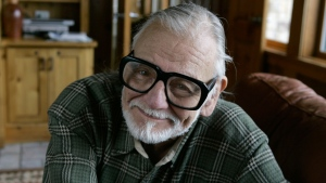 "In this Monday, Jan. 21, 2008 file photo, director and writer George Romero poses for a photograph while talking about his film ""Diary of the Dead' at the Sundance Film Festival in Park City, Utah.  (AP Photo/Amy Sancetta, File)"