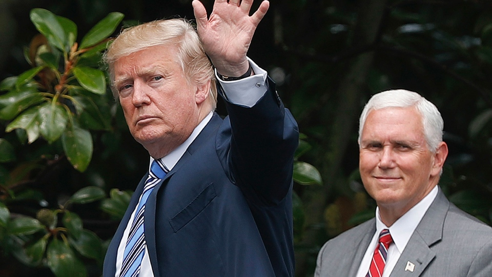 "President Donald Trump, accompanied by Vice President Mike Pence, waves during a ""Made in America,"" product showcase featuring items created in each of the U.S. 50 states, Monday, July 17, 2017, on the South Lawn of the White House in Washington. (AP Photo/Pablo Martinez Monsivais)"