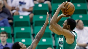 San Antonio Spurs' Treveon Graham (42) defends Boston Celtics' Malcolm Miller as he shoots during the first half of an NBA summer league basketball game Thursday, July 9, 2015, in Salt Lake City. (AP Photo/Rick Bowmer, Pool)