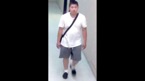 A man wanted in an animal cruelty investigation is seen in a surveillance camera image. (TPS)