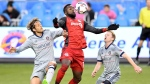 Toronto FC forward Jozy Altidore (17) brings down the ball as Chicago Fire defender Patrick Doody (22) and Chicago Fire midfielder Dax McCarty (6) move in during first half MLS soccer action in Toronto on Friday, April 21, 2017.  THE CANADIAN PRESS/Frank Gunn