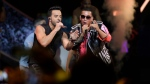 "FILE - In this April 27, 2017 file photo, singers Luis Fonsi, left and Daddy Yankee perform during the Latin Billboard Awards in Coral Gables, Fla. Universal Music Latin Entertainment announced Wednesday, July 19, 2017, that ""Despacito"" has become the most streamed song of all time with more than 4.6 billion plays six months after its release. The song by Luis Fonsi and Daddy Yankee, and a companion remix featuring Justin Bieber, has surpassed the 4.38 billion plays recorded for the previous record holder, which was Bieber's hit ""Sorry."" (AP Photo/Lynne Sladky, File)"