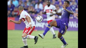 Orlando City's Cyle Larin (9) moves the ball past Toronto FC's Jason Hernandez (12) during an MLS soccer match Wednesday, July 5, 2017, in Orlando, Fla. (Stephen M. Dowell/Orlando Sentinel via AP)
