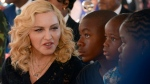 In this July 11, 2017 file photo, Madonna, left, sits with her adopted children David, Stella and Mercy, at the opening of The Mercy James Institute for Pediatric Surgery and Intensive Care, located at the Queen Elizabeth Central Hospital in the city of Blantyre, Malawi. (AP Photo Thoko Chikondi, File)