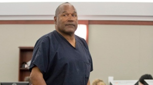 FILE - In this May 15, 2013 file photo, O.J. Simpson returns to the witness stand to testify after a break during an evidentiary hearing in Clark County District Court in Las Vegas. Simpson, the former football star, TV pitchman and now Nevada prison inmate, will have a lot going for him when he appears before state parole board members Thursday, July 20, 2017, seeking his release after more than eight years for an ill-fated bid to retrieve sports memorabilia. (AP Photo/Julie Jacobson, Pool, file)