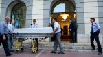 Workers bring a casket to the Dali Theater Museum in Figueres, Spain, Thursday, July 20, 2017.  (AP Photo/Manu Fernandez)
