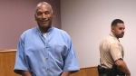 Former NFL football star O.J. Simpson enters for his parole hearing at the Lovelock Correctional Center in Lovelock, Nev., on Thursday, July 20, 2017. (Source: Jason Bean/The Reno Gazette-Journal via AP, Pool)