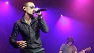 In this May 16, 2015 file photo, Chester Bennington, left, performs during the MMRBQ Music Festival 2015 at the Susquehanna Bank Center in Camden, N.J. The Los Angeles County coroner says Bennington, who sold millions of albums with a unique mix of rock, hip-hop and rap, has died in his home near Los Angeles. He was 41. Coroner spokesman Brian Elias says they are investigating Bennington's death as an apparent suicide but no additional details are available. (Photo by Owen Sweeney/Invision/AP, File)
