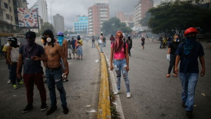 Anti-government demonstrators block a street during clashes with National Guards in Caracas, Venezuela, Thursday, July 20, 2017. (AP Photo/Ariana Cubillos)