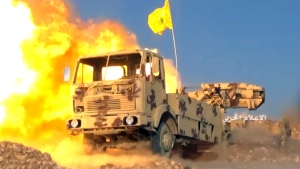 This frame grab from video released on Friday, July 21, 2017 and provided by the government-controlled Syrian Central Military Media, shows a Hezbollah cannon pounding militants' positions on the Lebanon-Syria border. The Syrian army and members of Lebanon's militant Hezbollah group launched a major ground offensive on Friday aiming to end years long presence of hundreds of militants in a border area between the two countries. (Syrian Central Military Media, via AP)