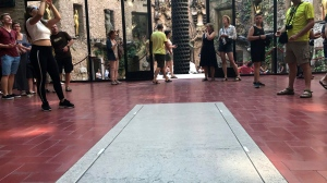 Visitors stand near the tomb of Salvador Dali inside Dali Museum Theatre in Figueres, Spain, Friday, July 21, 2017. The samples of hair, nails and two long bones removed overnight from Salvador Dali's embalmed remains could open a judicial battle for the artist's estate if genetic tests prove that he had fathered a girl decades ago. Forensic experts removed on Thursday night the biological samples from a crypt in Figueres, in a sensitive operation that involved pulleys lifting a 1.5-ton stone slab. (AP Photo/Hernan Munoz)