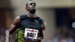 Jamaica's Usain Bolt crosses first the finish line in the men's 100m race at the IAAF Diamond League Athletics meeting at the Louis II Stadium in Monaco, Friday, July 21, 2017. Eight-time Olympic champion Usain Bolt competes in his final Diamond League meeting ahead of next month's world championships and his impending retirement.(AP Photo/Claude Paris)