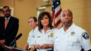 Minneapolis police chief Janee Harteau, center, stands with police inspector Kathy Waite, left, and assistant chief Medaria Arradondo during a news conference Thursday, July 20, 2017, Minneapolis. The family of an Australian woman shot dead by a Minneapolis police officer wants changes in police protocols, including a look at how often officers are required to turn on their body cameras, a family attorney told local media. (Maria Alejandra Cardona/Minnesota Public Radio via AP)