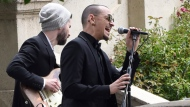 "In this May 26, 2017 file photo, Chester Bennington, of Linkin Park, performs ""Hallelujah"" at a funeral for Chris Cornell at the Hollywood Forever Cemetery in Los Angeles. The Los Angeles County coroner says Bennington, who sold millions of albums with a unique mix of rock, hip-hop and rap, has died in his home near Los Angeles. He was 41. Coroner spokesman Brian Elias says they are investigating Bennington's death as an apparent suicide but no additional details are available. (Photo by Chris Pizzello/Invision/AP, File)"