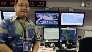 Jeffrey Wong, the Hawaii Emergency Management Agency's current operations officer, shows computer screens monitoring hazards at the agency's headquarters in Honolulu on Friday, July 21, 2017. Hawaii is the first state to prepare the public for the possibility of a ballistic missile strike from North Korea. (AP Photo/Jennifer Sinco Kelleher)