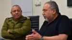 This handout photo provided by the Israeli military on Saturday, July 22, 2017, shows Israel's defense minister, Avigdor Lieberman talking to army chief Lt. Gen. Gadi Eizenkot at an Israeli military base in the West Bank. Israel has sent more troops to the West Bank. This comes a day after a Palestinian stabbed to death three members of an Israeli family in their home and after widespread Israeli-Palestinian clashes erupted over escalating tensions at the Holy Land's most contested shrine. (Israeli military via AP)