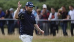 South Africa's Branden Grace waves as he makes his way along the 18th fairway during the third round of the British Open Golf Championship, at Royal Birkdale, Southport, England, Saturday July 22, 2017. (AP Photo/Peter Morrison)
