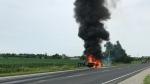 A dump truck is seen on fire on Simcoe County Road 50 on July 22, 2017. (Geoff Hobbs)