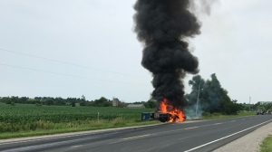 A dump truck is seen on fire on Simcoe County Road 50 on July 22, 2017. (Geoff Hobbs)