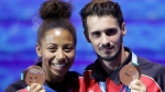 Canada's bronze medalists Jennifer Abel, left, and her teammate Francois Imbeau-Dulac pose after the award ceremony for the mixed 3 meter springboard diving final at the 17th FINA World Championships 2017 in Budapest, Hungary, Saturday, July 22, 2017. (AP Photo/Michael Sohn)