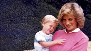 "In this photo made available by Kensington Palace from the personal photo album of the late Diana, Princess of Wales, shows the princess holding Prince William whilst pregnant with Prince Harry, and features in the new ITV documentary 'Diana, Our Mother: Her Life and Legacy.' Prince William and Prince Harry will pay tribute to their mother, Princess Diana, as the 20th anniversary of her death in a car crash approaches in a TV documentary ""Diana, Our Mother: Her Life and Legacy"" which will air Monday July 24, 2017 on British TV. (The Duke of Cambridge and Prince Harry/Kensington Palace via AP)  NO USE ON THE FRONT COVERS OF ANY UK OR INTERNATIONAL MAGAZINES. NO COMMERCIAL USE (including any use in merchandising, advertising or any other non-editorial use including, for example, calendars, books and supplements)."
