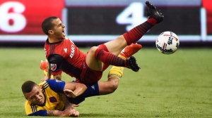 Colorado Rapids defender Kortne Ford (24) and Toronto FC forward Sebastian Giovinco (10) battle for the ball during second half MLS soccer action in Toronto on Saturday, July 22, 2017. THE CANADIAN PRESS/Nathan Denette