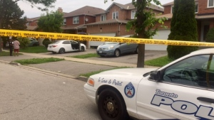 A police cruiser is shown at the scene of a triple shooting on Gennela Square in Scarborough early Sunday morning.