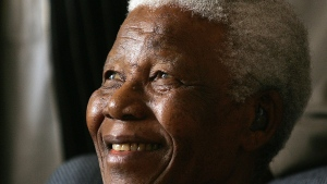 In this Jan. 31, 2006 file photo former South African President Nelson Mandela smiles during his meeting in Johannesburg, South Africa. Some relatives of Mandela say a new book by a military doctor that documents Mandela's treatment before his 2013 death violates doctor-patient confidentiality. However, the now-retired doctor, Vejay Ramlakan, said in an interview broadcast over the weekend on the eNCA news channel that the Mandela family had requested that the book be written. (AP Photo/Themba Hadebe, File)