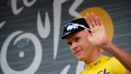 Britain's Chris Froome, wearing the overall leader's yellow jersey, gestures at the start of the twenty-first and last stage of the Tour de France cycling race over 103 kilometers (64 miles) with start in Montgeron and finish in Paris, France, Sunday, July 23, 2017. (AP Photo/Christophe Ena)