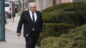 Winston Blackmore, who is accused of practising polygamy in a fundamentalist religious community, returns to court after a lunch break in Cranbrook, B.C., Tuesday, April 18, 2017. A verdict is expected Monday in a trial of two former leaders of a British Columbia fundamentalist church who are charged with polygamy. B.C. Supreme Court Justice Sheri Ann Donegan has been presiding over the trial of Winston Blackmore and James Oler, who are accused of having multiple wives.THE CANADIAN PRESS/Jeff McIntosh
