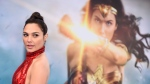 "FILE - In this May 25, 2017 file photo, Gal Gadot arrives at the world premiere of ""Wonder Woman"" in Los Angeles. The film grossed $103.1 million in North America over its debut weekend, a figure that easily surpassed industry expectations, set a new record for a film directed by a woman and bested all previous stand-alone female superhero movies put together. (Photo by Jordan Strauss/Invision/AP, File)"