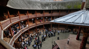 An actor performs a scene from William Shakespeare's Hamlet for members of the media and a small audience during a photo call to present Hamlet at Shakespeare's Globe theatre, London, Wednesday, April 23, 2014. (AP Photo/Lefteris Pitarakis)