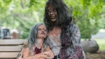 Leanne MacRae, and her daughter Miranda sit on a bench after attending a memorial service dressed up as zombies, to pay tribute to zombie film director George Romero, who passed away at the age of 77, at Mount Pleasant Cemetery, in Toronto, Ont., Monday July 24, 2017. THE CANADIAN PRESS/Mark Blinch