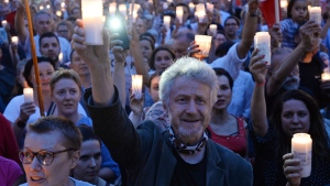 People gather for a candle lit protest in front of the Supreme Court in Warsaw, Poland, Monday, July 24, 2017.  (AP Photo/Alik Keplicz)